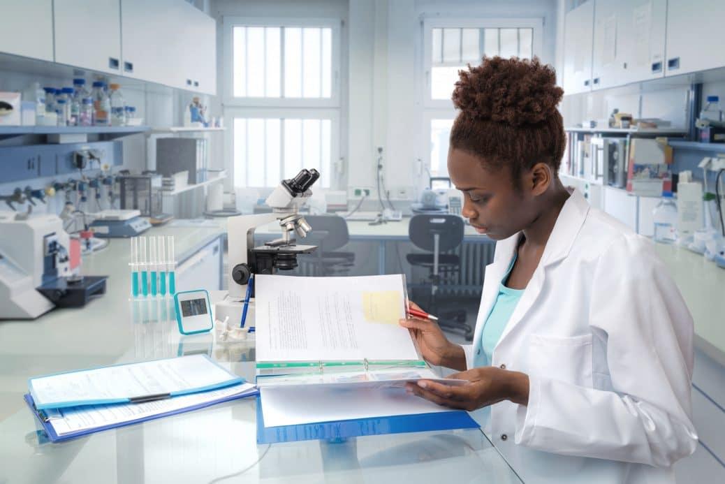 Medical worker or scientist works in modern biological laboratory